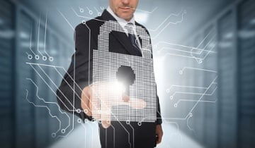Businessman selecting a futuristic padlock with a data center on the background-1
